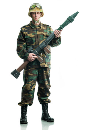 guerrilla warfare: Soldier in camouflage with a weapon