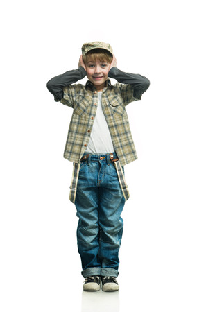 Cheerful boy in a jeans on the white background photo