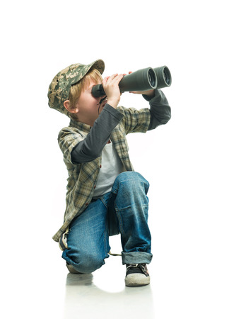 attentiveness: Little boy in a jeans with a binoculars