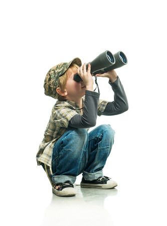 trailblazer: Little boy in a jeans looking through binoculars Stock Photo