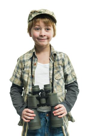 Little boy in a jeans with a binoculars