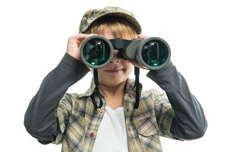 Little boy in a jeans looking through binoculars Stock Photo