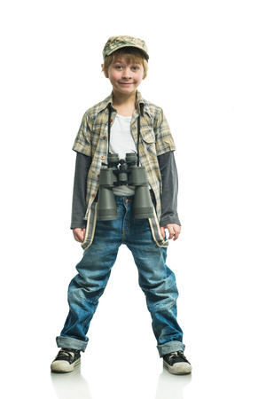 naturalist: Little boy in a jeans with a binoculars