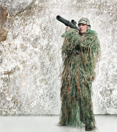 marksman: Soldier in camouflage with a weapon