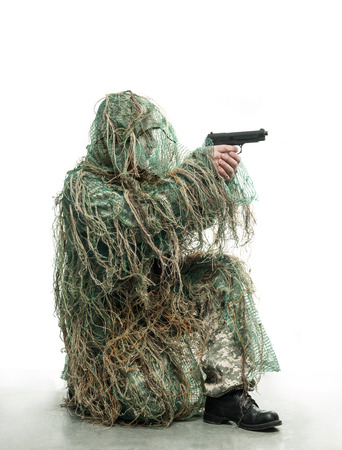 rifleman: Soldier in camouflage with a gun Stock Photo