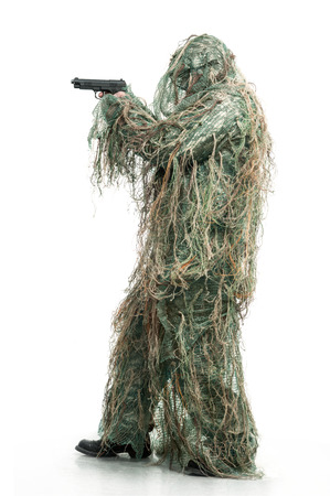 guerrilla warfare: Soldier in camouflage with a gun Stock Photo