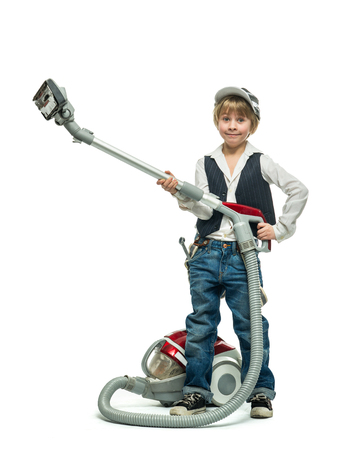 assiduous: Little boy with vacuum cleaner