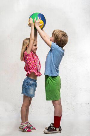 intercourse: Boy and girl holding a ball Stock Photo