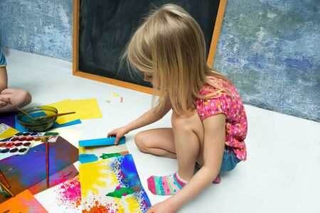 painted image: Little girl draws of water color