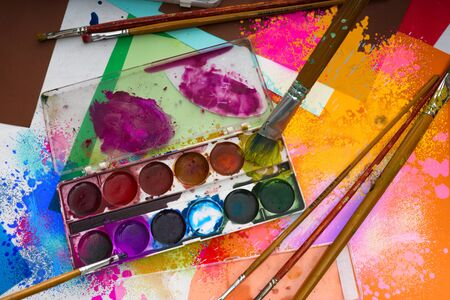 abstract paintings: Watercolor paints brushes and abstract paintings Stock Photo