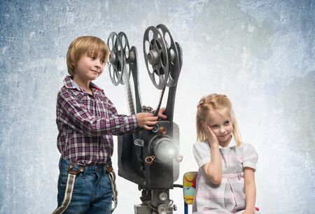 holiday movies: Girl and boy with a film projector