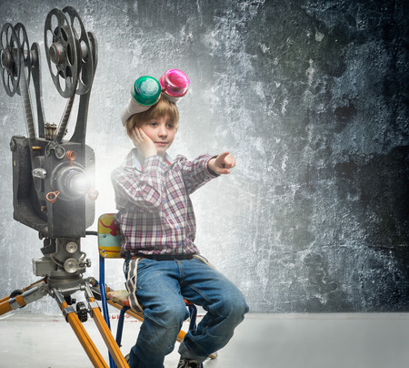 holiday movies: Little boy with a film projector Stock Photo