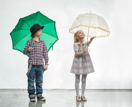 love in rain: Girl and boy under the umbrellas