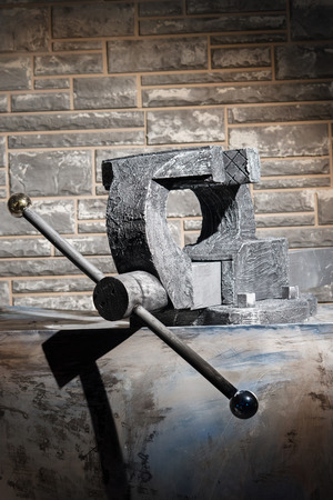 grip: Grip vice on the background of brick wall