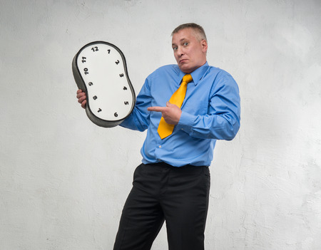 endlessness: Clock without hands in the hands of man Stock Photo