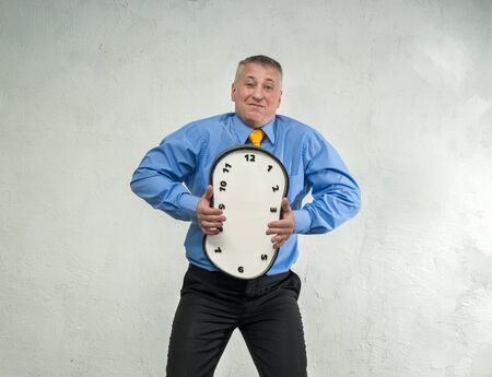 Compressed clock without hands in the hands of man