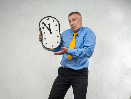constricted: Clock without hands in the hands of man Stock Photo