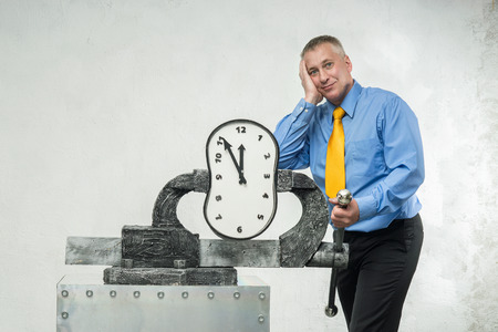 A man grabs a time in a vise