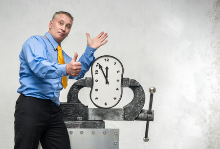A man grabs a time in a vise photo