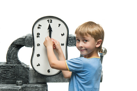 Boy takes the arrows on the clock Stock Photo
