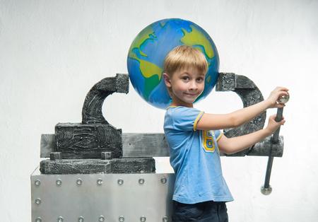 vice grip: A little boy holding a globe
