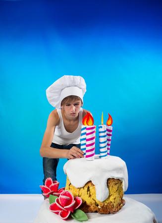 decorates: Funny confectioner decorates a birthday cake Stock Photo