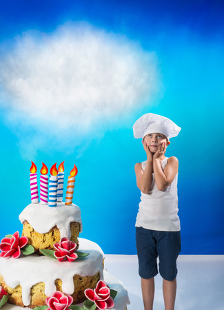 Little confectioner with a birthday cake Stock Photo