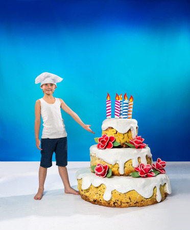 specific clothing: Little confectioner with a birthday cake Stock Photo