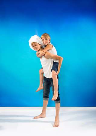 Portrait of the two boys on the blue background photo