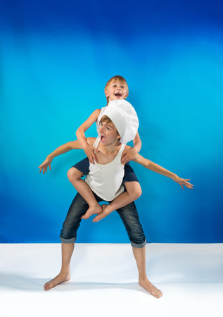 Portrait of the two boys playing on the blue background photo