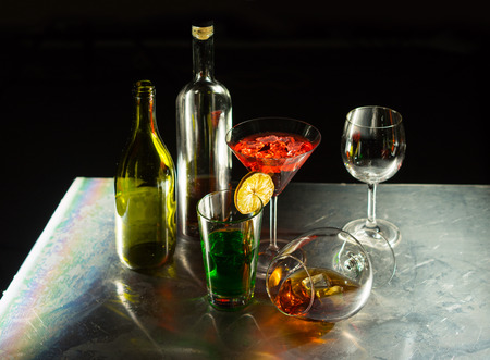 abstract liquor: Bottles and glasses of wine on the black background Stock Photo