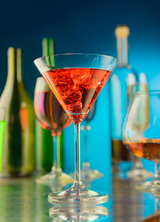 bar drinks: Wineglass with a wine and ice on the table