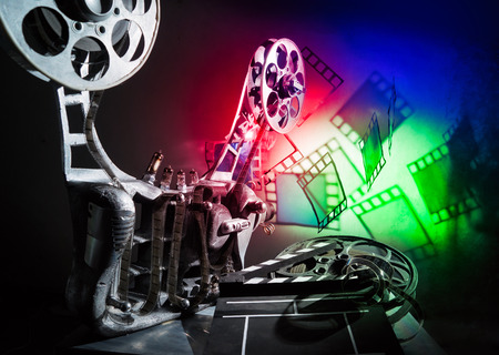cinematographer: Movie projector and a film on the bright background