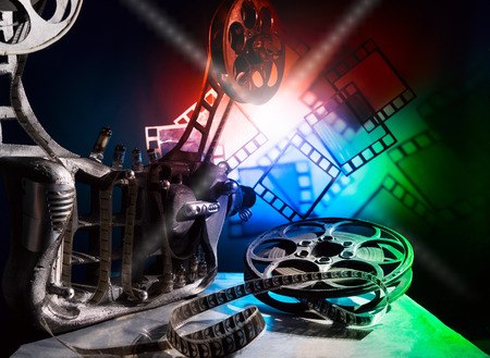 cinematographer: Movie projector with a beam of light and a color film Stock Photo