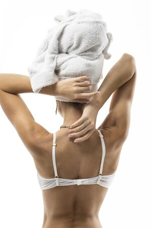nude female body model: View of a sexy womans  back with a towel on her head