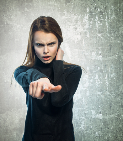 indignant: Portrait of angry girl with a outstretched hand