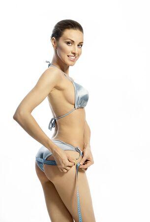 junge nackte m�dchen: D�nne Frau mit einem Ma�band auf den H�ften Lizenzfreie Bilder