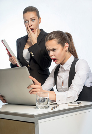 gaze: Two beautiful women gaze into computer