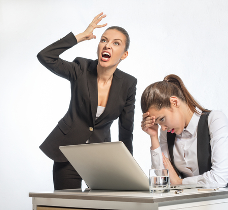 resentful: Angry teacher and resentful student at the computer