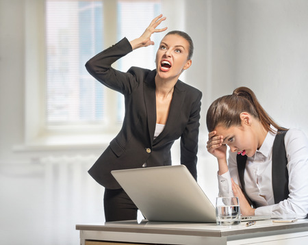 dispirited: Angry boss shouts at a junior in office