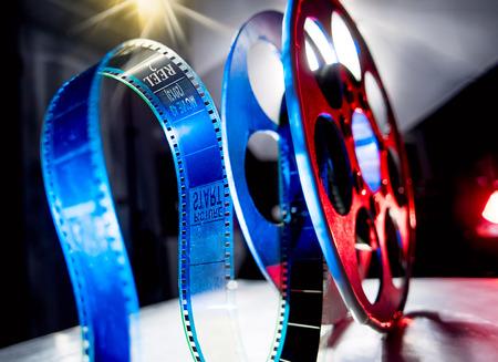 blue film: Red reel of blue film on a dark background