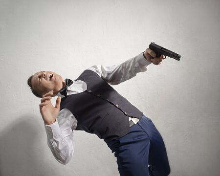 disclosure: Wounded agent falls with a gun in his hand