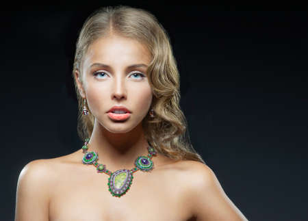 sensuality: Portrait of sensuality girl with blue eyes and a necklace abound his neck