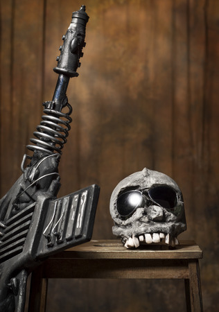 undoing: Weapon and skull on a stool on the old background