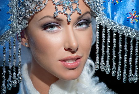 Portrait of a snow maiden in a beautiful blue crown