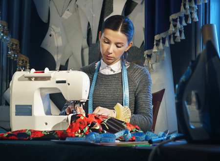 Seamstress working at a sewing machine
