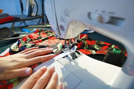 needlewoman: Seamstress working in a sewing machine closeup Stock Photo