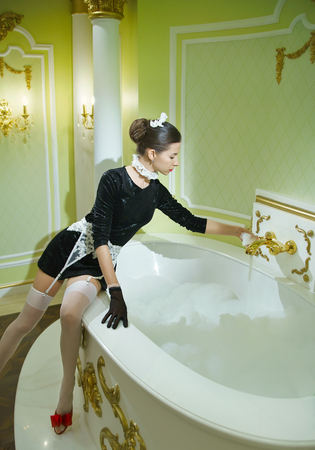 Sexy maidservant is in a luxury bathroom