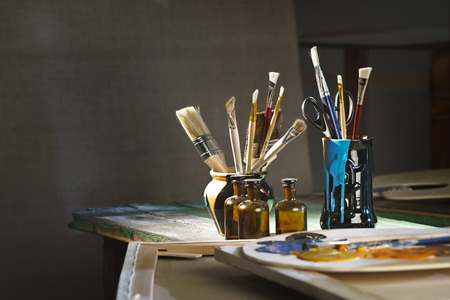 can pattern: Artists workshop with a paints, tables, easels and stretchers