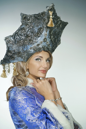 russian ethnicity: Portrait of a beautiful snow maiden in a crown and coa